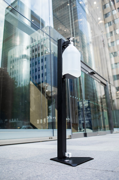 One Gallon Hand Sanitizer Stand in front of a building