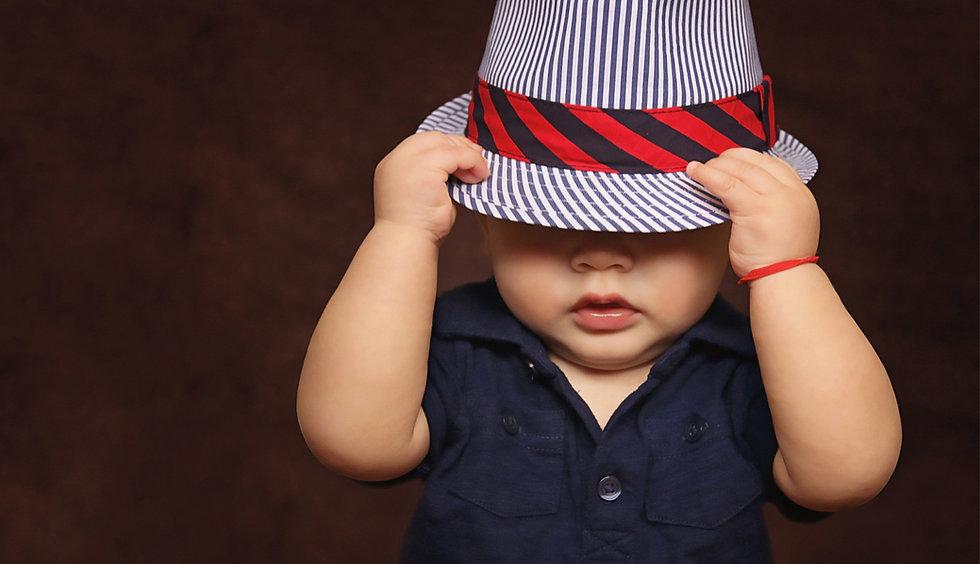 toddler in hat landscape.jpg