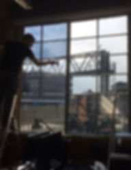 Window film installer at work