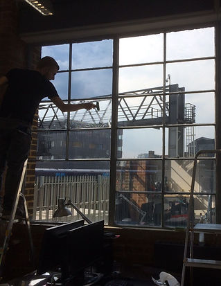 Window film installer at work