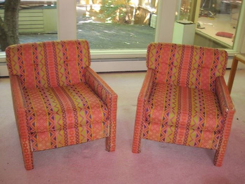 Pair of Segfield Directional Design chairs, wear to arms