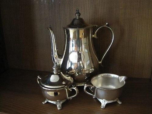 "International silver tea set, 10"" tall"
