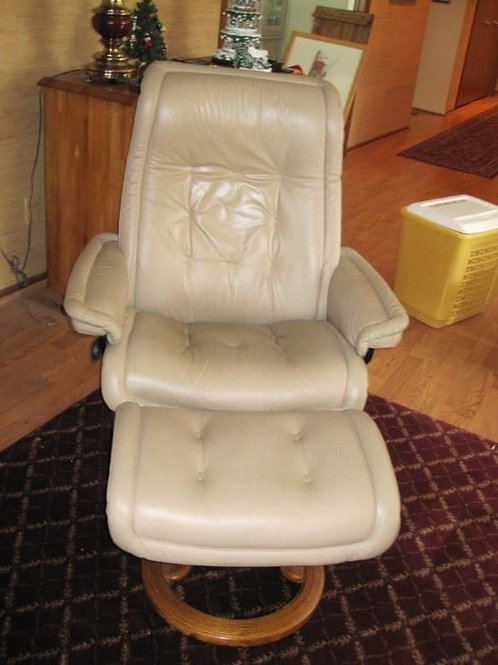 Ekornes Stress Chair and ottoman.  Has some leather damage on a seam.