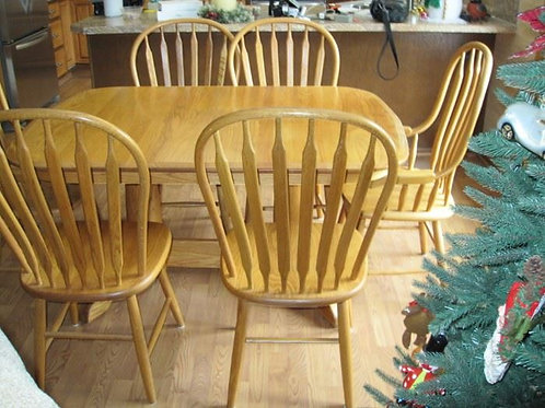 """Amish Table and 6 chairs with two self storing leaves 57 x 40"""" w/o leaves"""