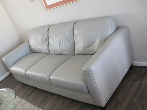"originally 3400.00, .87"" long 36"" deep, Dove Gray leather sofa 2 years old"
