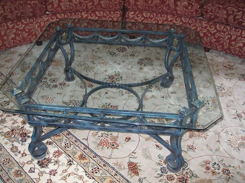 "Heavy wrought iron coffee table, 40"" x 17"" T"