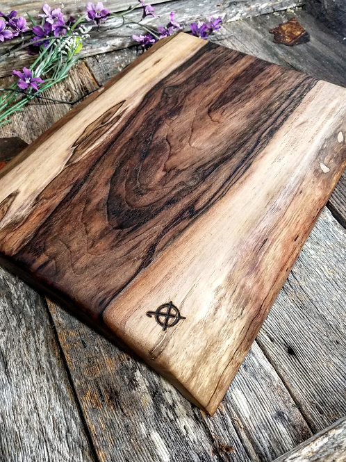 Live edge walnut slab board with finger holds
