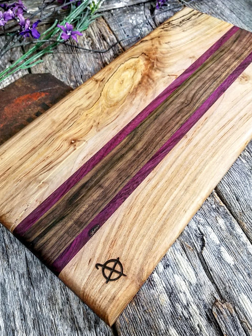 Spalted maple,  purpleheart,  and walnut.