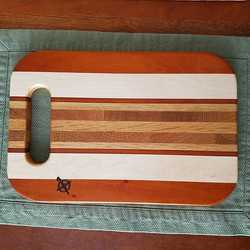 Love this board! Teak (best I can tell,  reclaimed from an old bed frame railing) maple,  cherry,  o