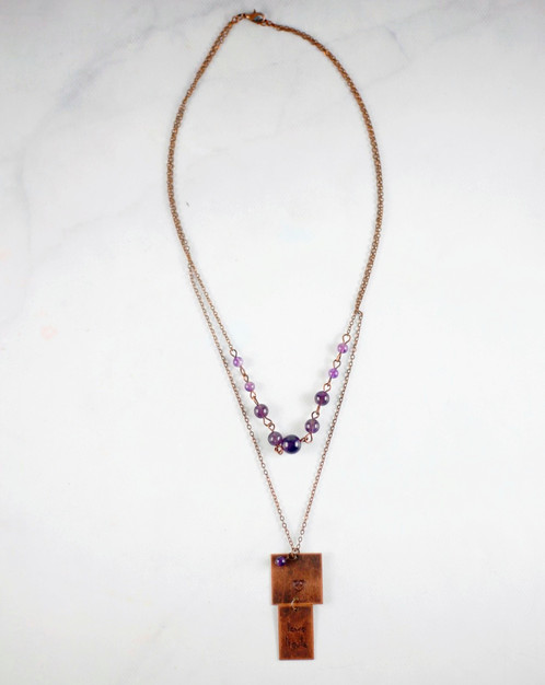 Love heals with square pendant necklace swat ministries a square pendant stamped love heals with a strand of beads either purple or blue aloadofball Image collections