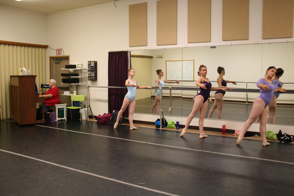 Advanced students taking daily ballet class