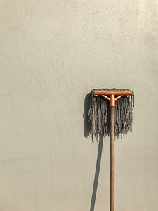 gray-and-brown-floor-mop-on-white-wall-3
