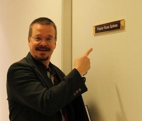 Russ at his office door.jpg