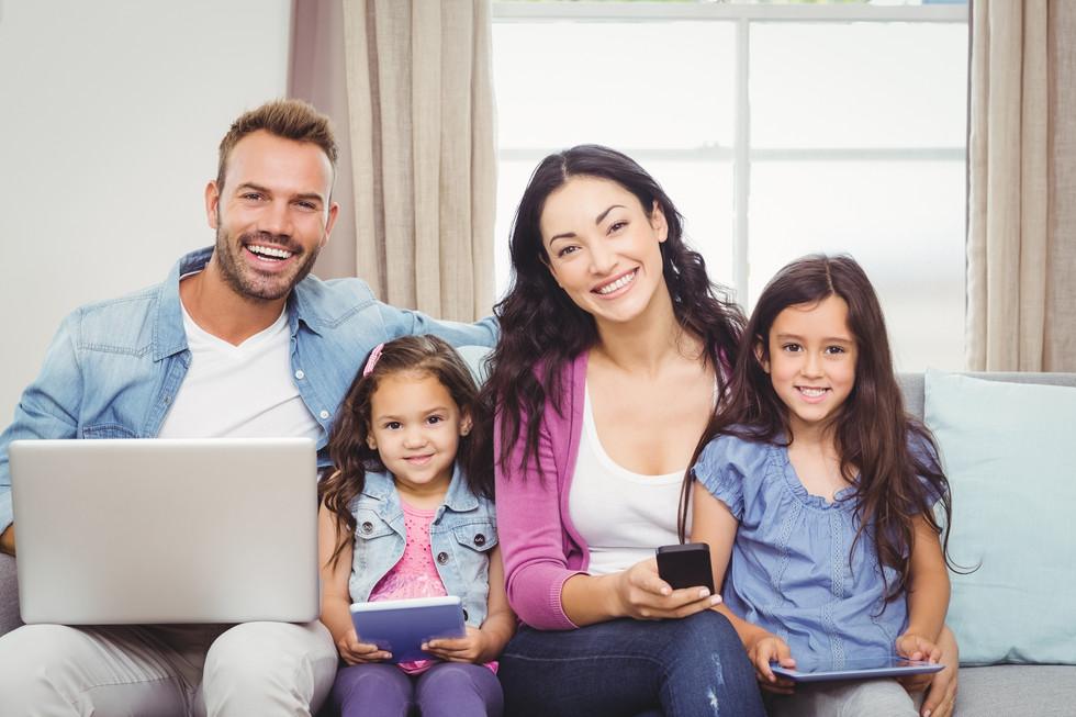 happy-family-using-modern-technologies-w
