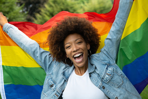 Cinematic shot of happy young african woman carrying flag of LGBT rainbow symbol and smili