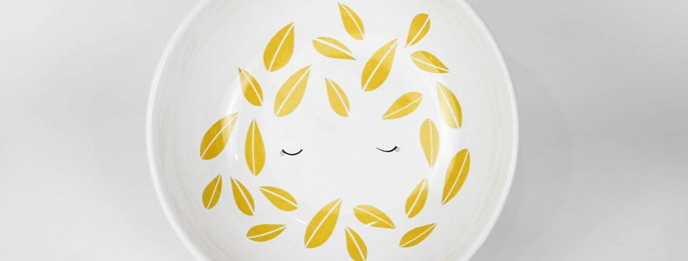 Girl with leaves - yolky yellow bowl