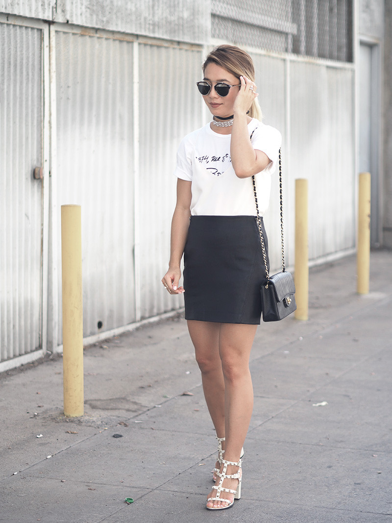 Leather Miniskirt with Layered Tee and Chanel Bag