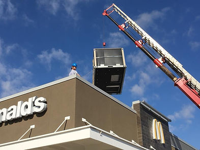 Trent on top of the McDonald's in Stillwater helping install a new Lennox packaged unit.