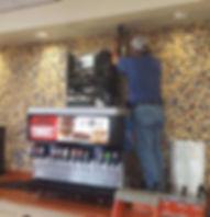 Troy from Advantage working on a soda machine in Stillwater.