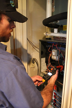 Trent from Advantage performing a fall Preferred Customer Service Agreement (PCSA) on a furnace in Stillwater.