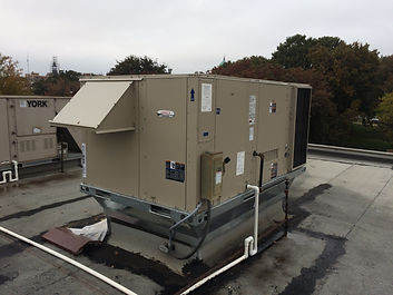 A Lennox packaged unit installed on top of The Hideaway in Stillwater by Troy and other Advantage team members.