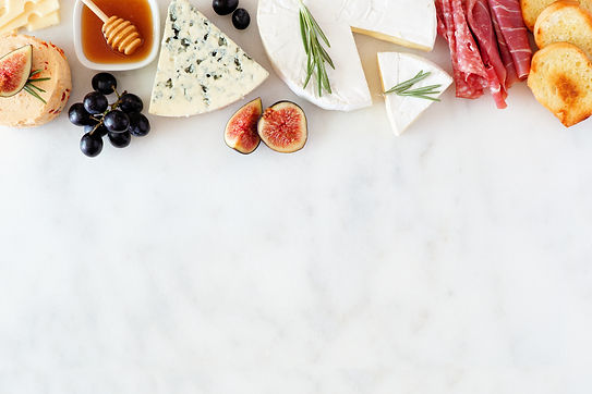 Assorted cheeses and meat appetizers. To