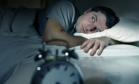 Man In Bed With Eyes Opened Suffering Insomnia And Sleep Disorder.jpg