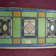 Pre-restoration 1920's window
