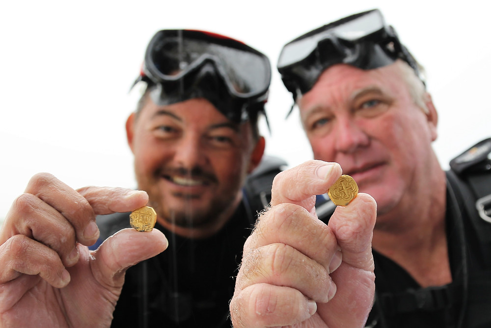 Diver Josh Fisher and Capt. Dan Porter recover gold coins!