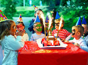 happy kids around birthday cake.jpg