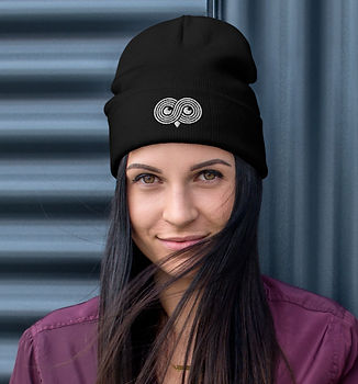 young woman wearing another selloutoff hat beanie toque from Another Sellout, selling merch for marketing and advertising agency professionals