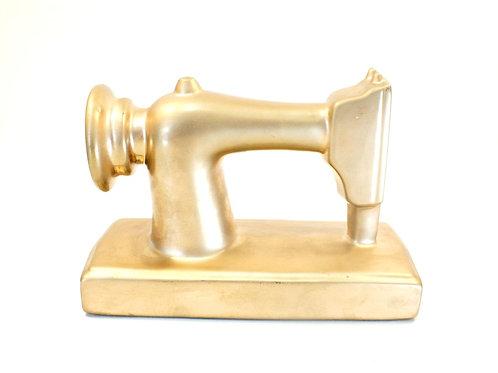 Máquina de Costura Dourada