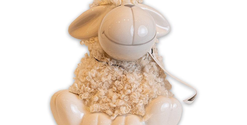 Mouton assis GM