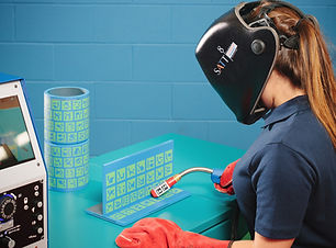 Student using a welding training simulator