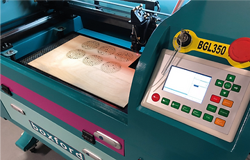 Boxford 50 watt C02 laser cutter cuttiung and engraving plywood