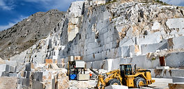 industrial-machinery-in-an-open-cast-marble-quarry-TXMWN8N.jpg
