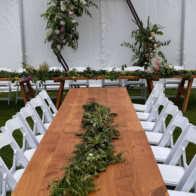 Hex arch and rustic tables