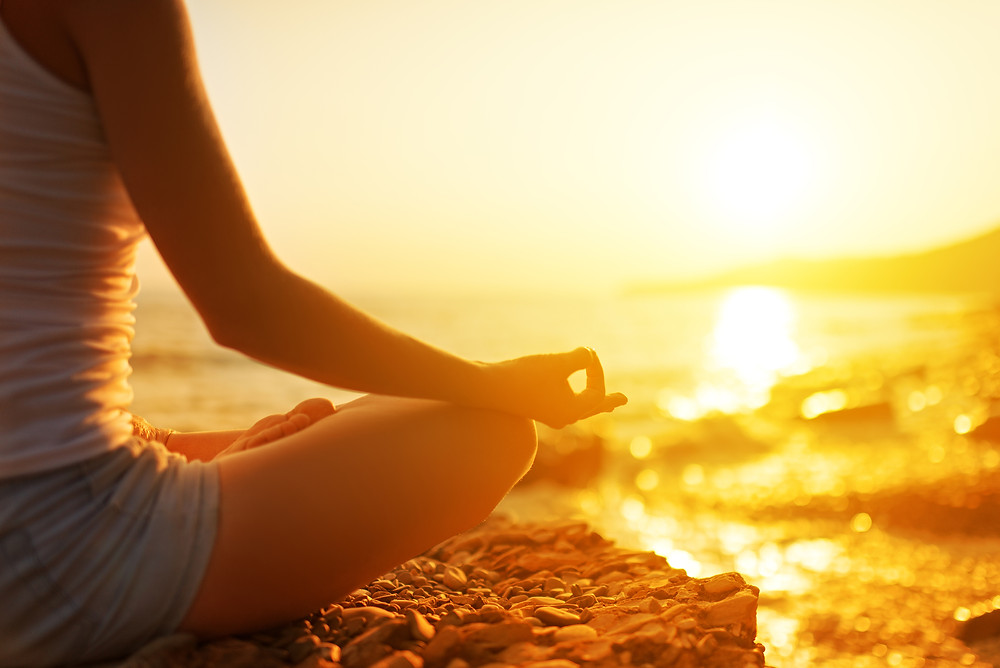 Hand Of  Woman Meditating In A Yoga Pose On Beach.jpg
