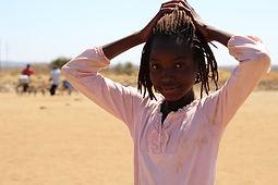 A student from a village nearby Maanu Mwambi School