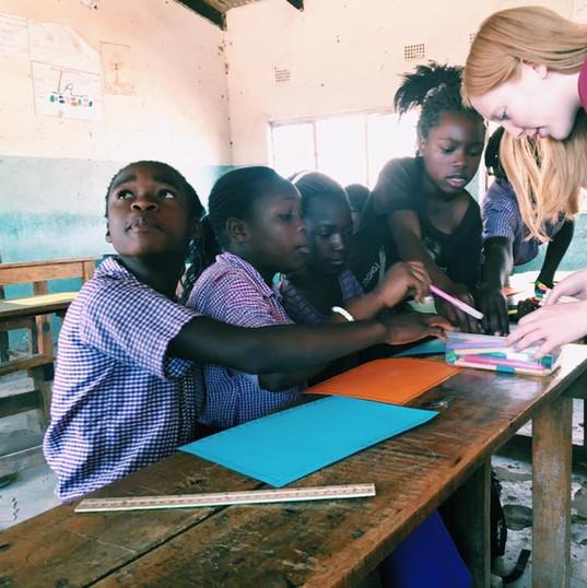 Katie helping kids at Maanu Mwambi