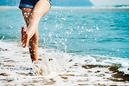 girls splashing in waves.jpg