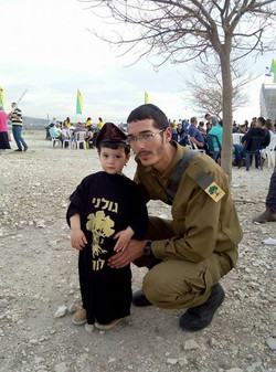 Okay. I have to post this. Here's my great nephew, Eitan, with his uncle Binyamin, who is a student