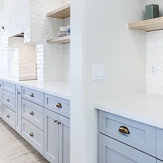 white walls with light blue ktichen cabinets
