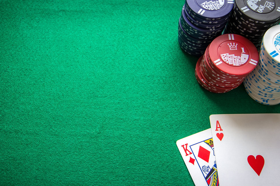 Texas Holdem - chips, cards and dealer button on green table ..jpg