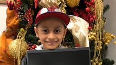 All smiles! Rodrigo receives laptop from Heroes