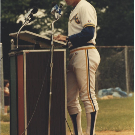 Coach speaking at the 1987 parade ceremonies.