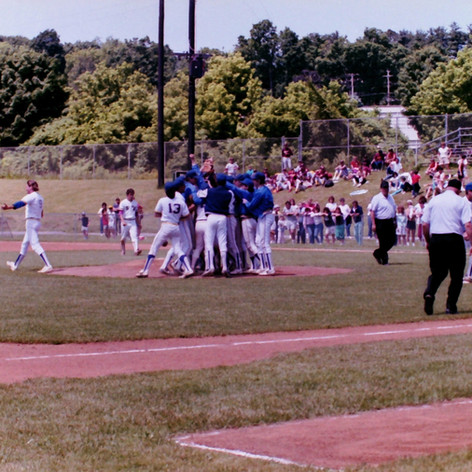 Players celebrate on moiund after semi-final victory over Watervliet.