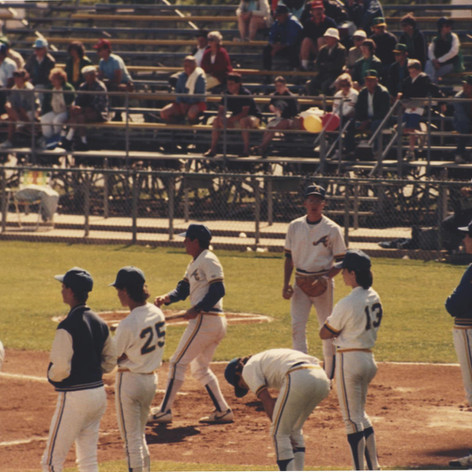 Coach hitting infield prior to the 1987 championship game