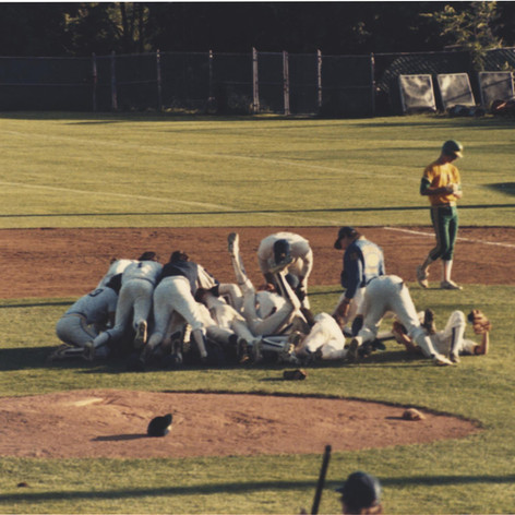Dogpile celebration after the final out vs. Greene in the championship game