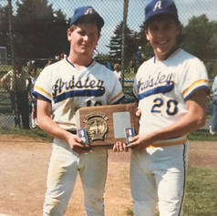 Seniors Mike Ferraguzzi and Brad Chenard holding 1988 Sectional trophy.